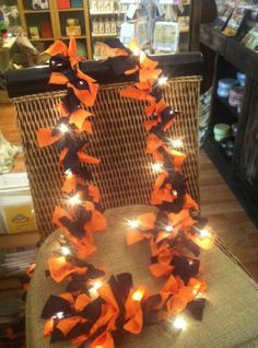 Halloween Lighted Garland! Get a couple yards of the cheapest fabric, cut into strips, and tie them in a knots between lights on a white light strand. So easy and festive!