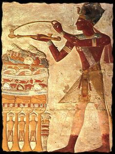 King Rameses II skillfully throwing an incense grain into an incense pipe to fumigate the offerings piled before him, already nesting 2 alabaster bowls of burning myrrh. 19th dynasty. Ancient Egypt.