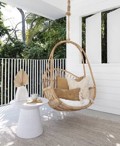 The Folk cushion is the perfect finishing touch to this outdoor setup from Sea Tribe, featuring a hanging cane chair Cosy Corner, Modern Bungalow, Swinging Chair, Modern Boho, Modern Coastal, Inspired Homes, Porch Decorating, Boho Decor, Outdoor Chairs