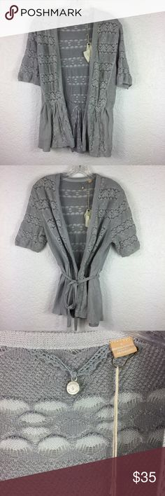 """Anthropologie Knitted & Knotted Lace Cardigan L Anthropologie Knitted and Knotted Lace stitch Cardigan short sleeve gray sweater new with tag (price tag was removed). Super light delicate open weave.  Looks good tied multiple ways. Approximate measurements are armpit to armpit 18"""" along back length 25"""" at longest point Anthropologie Sweaters Cardigans"""