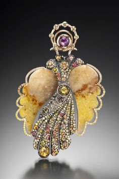 """""""Venus""""  An 18k yellow and white gold """"Angel"""" broch, pendant and earring jacket,"""" Venus"""" set with 6.73 total carat weight rose cut sapphires, 1.15 total carat weight round sapphires, and 4.50 total carat weight facted yellow diamonds and druzy wings. Designed and made by llyn strong."""
