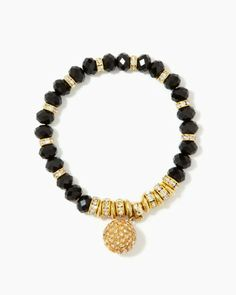 Shop holiday party jewelry online. Perfect for holiday parties or winter formals, a black beaded bracelet featuring rhinestone spacers and one large dangling pavé bead that reminds us of a sparkling disco ball.