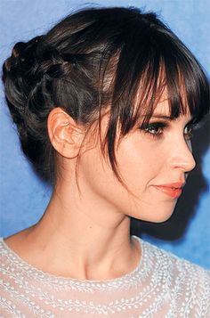Braid two plaits, one on either side of your head. Gather them in back, then twist together to form a bun.