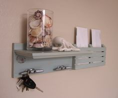 Shabby Chic Nautical Beach Cottage Key ring Mail holder Boat Cleat Organizer Shelf Coat Hat Rack Hanger Hooks in Distressed Watery Blue. $39.95, via Etsy.