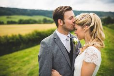 Image by Photography34 - A rustic styled low budget DIY wedding with outdoor venue, handmade bridal gown and handmade bridesmaid dresses. High street tweed groomsmen and dove grey colour scheme.