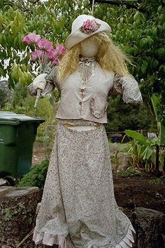 Pretty Garden Lady.  Time for another trip to the Goodwill store.