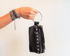 Black Studded Leather Evening Clutch, Leather wristlet Handbag, Black Leather Clutch, Women Evening handbag, Metal ring bag with studs  Hand made with love, my leather clutch is perfectly sized for your evening essentials or daily needs. Made from supple black leather, this chic pouch can be used as an evening bag, a wallet or a makeup case. Its wristlet metal ring allows your hands to stay free and enjoy the party! Comes in a variety of colors, perfect for a gift, celebration, mothers day…