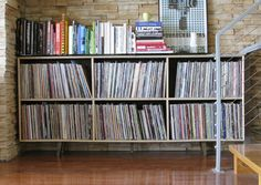 Record Shelf made by KNIFE & SAW.. I really want this for my living room