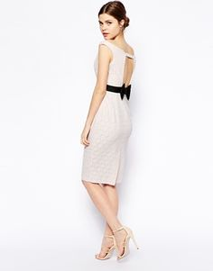ASOS Bow Back Lace Pencil Dress... this is the dress I bought... but in turquoise... Lets hope it fits and that I can find a bra to wear with it! HAHA!