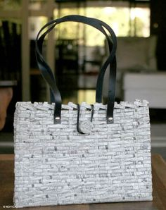 WANT. Woven recycled newspaper handbag