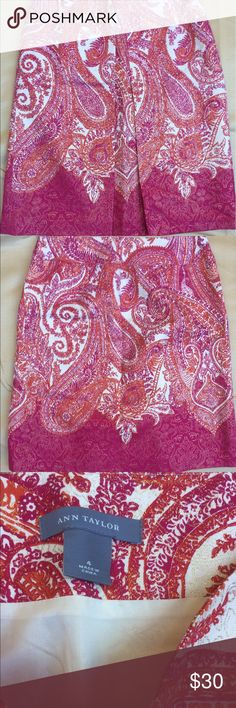 """Ann Taylor paisley skirt with front pleat size 4 Excellent condition Ann Taylor paisley skirt with front pleat size 4. Beautiful pinks and orange mixed in with hints of gold. Approx measurements Length 20.5"""" Waist 16"""" Ann Taylor Skirts A-Line or Full"""