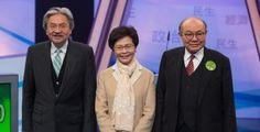 Hong Kong chief executive election candidates John Tsang (L), Carrie Lam (C), and Woo Kwok-hing (R), pose during a photo call before participating in a televised debate in Hong Kong, China, 14 March 2017.