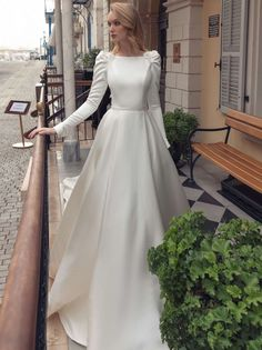 Royal-inspired mikado princess wedding dress in bateau neckline, featuring leg-of-mutton long sleeves and sensual open back with floral embroidery appliqués. Princess Wedding Dresses, Modest Wedding Dresses, Elegant Wedding Dress, Rustic Wedding, Ball Dresses, Ball Gowns, Muslimah Wedding Dress, Dress Muslimah, Bridal Gowns