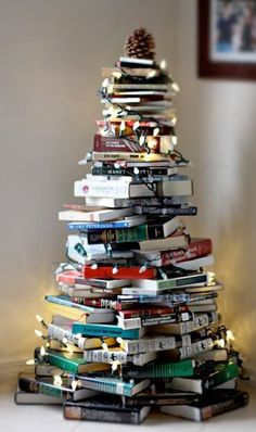 Thinking about having an alternative Christmas tree? Want to see the best ideas? We've rounded up the top 16 alternative Christmas tree ideas. Book Christmas Tree, Book Tree, Christmas Hacks, Winter Christmas, All Things Christmas, Christmas Holidays, Christmas Decorations, Merry Christmas, Holiday Decorating