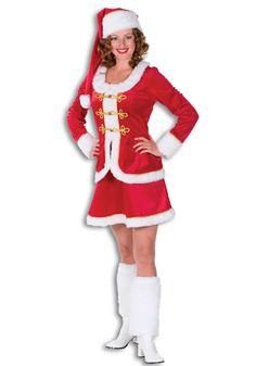 Luxe kerstvrouw kostuum voor dames. Mooi kerstvrouwen kostuum van fluweel in de kleur rood, met witte en goudkleurige details. Het kostuum bestaat uit een jurk, een muts en witte beenwarmers. Kerst kostuums bij Fun en Feest #kerstjurkjes