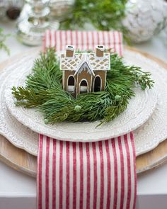 how cute is this idea for a Christmas table? love the wreath, gingerbread house on the striped napkin and white plats Christmas . Woodland Christmas, Merry Little Christmas, Noel Christmas, Winter Christmas, Christmas Vacation, Outdoor Christmas, Christmas Lights, Canada Christmas, Christmas Tabletop