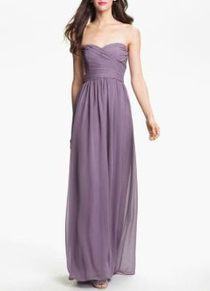 A soft purple bridesmaid dress with a traditional sweetheart neckline.