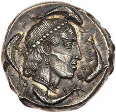 Silver tetradrachm of Syracuse, Sicily, 440 BCE. Diademed head of Arethusa, four dolphins. ΣYRΑΚΟΣΙΟΝ