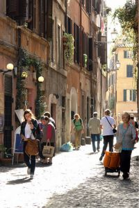 "Located on the west bank of the Tiber, Trastevere literally translates to ""across the Tiber."""