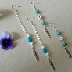 turquoise  duster long  earrings  from three moons  boutique  on  etsy  ,skull and feathers