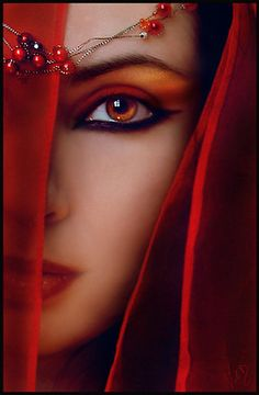 The red lady, Melisandre is a priestess of an eastern religion which is little-known in Westeros