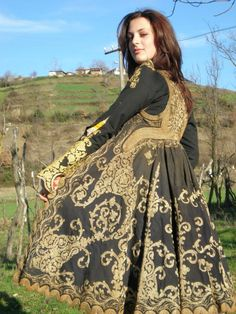 Masterpieces of Albanian embroidery. This is a full traditional costume from Gramsh, Albania. It is made in Elbasan, Albania in the 19th century. The costume is full and consists of: robe, vest, shirt, fustanella, head scarf, sash, shoes,apron, underwear, necklace.