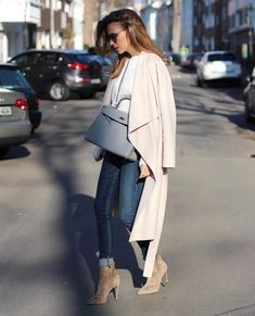 """Alexandra Lapp is seen here in a gorgeous oversized wrap coat, worn over rolled denim jeans and a light blue sweater. She pairs this with suede spike-heeled boots. Jeans: Rag & Bone, Shoes"""" Gianvito Rossi."""