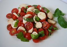 Yum!  Caprese salad  Fresh basil, cherry tomatoes, mozzarella pearls.  Half tomatoes and tomatoes.  Cut basil with scissors.  Dressing: olive oil, red wine vinegar or balsamic vinegar, salt and pepper.  Drizzle, mix gently.