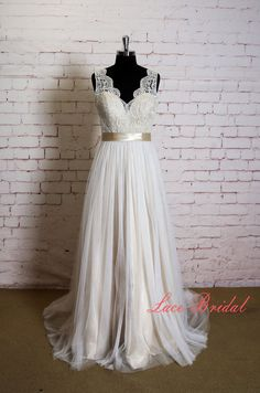 This might be a good way to add some oomph to the dress: More chiffon on the bottom and lace on top.   Elegant Lace Wedding Dress with V Neck Simple by LaceBridal