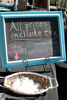 Clear signage at a craft fair and a little treat for shoppers.