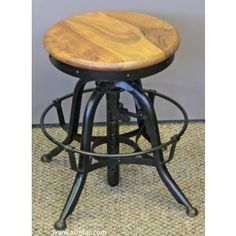Backless Dining/Counter Chair  This bold and rustic industrial dining/counter chair backless and round top, features adjustable seat height,...