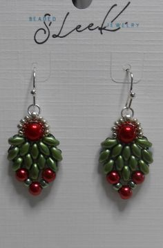 These measure 1-1/2 from the earlobe. These are so cute for the holiday season. Green super duo beads surround a 6mm red glass pearl and below 4mm red glass pearls. Two pale green/blue 8mm seed beads are used along with 11mm silver seed beads leading up to silver plated earring wires.