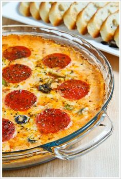 Pizza Dip. Use smaller pepperoni so they can be picked up on your bread and can share them more :)