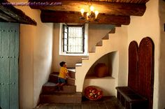 Spanish colonial style home interior. This can work inside of an Italianate home very well to keep everything casually chic!