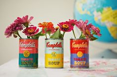 Pay homage to Andy Warhol with these adorable vases, made by adding glossing spray to empty containers of Campbell's Tomato Soup. Get the tutorial at Ashley Ann Photography, and a free Warhol Campbell's soup can printable at Katie Day Photography. Tin Can Crafts, Diy And Crafts, Soup Can Crafts, Andy Warhol Soup Cans, Campbell's Soup Cans, Diy Recycling, Upcycle, Do It Yourself Furniture, Flower Vases