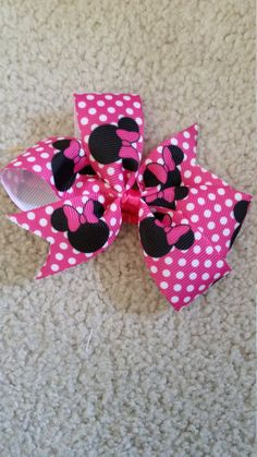 Check out this item in my Etsy shop https://www.etsy.com/listing/264182754/minnie-mouse-hair-bow-hair-clip-minnie