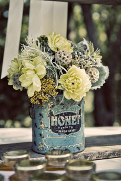 Pale yellows and tans blend beautifully with the blues and grays of this rustic, country centerpiece.