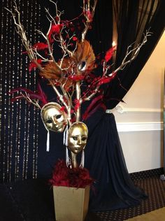 Spray painted tree with masks - somehow make it cooler (add beads or pearls) and use as decoration for a masquerade ball!