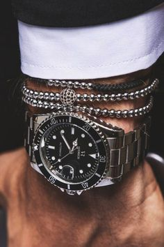 This stack works well together. And it looks clean and expensive, something men's jewelry doesn't always do. http://amzn.to/2ttwUNA