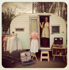 """If I ever start doing a ton of art shows, a little """"trailer"""" shop like this might be a nice alternative to a tent - you can set everything up beforehand, not worry about the weather or leaking tents, and then lock it up during overnight shows without having to worry about theft or storms during the night.... Clever idea!"""