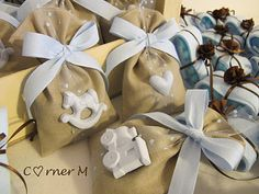 gift bags idea. the ornament can be stamped on the back with the date of your baby shower or your due date etc... then your family and friends can hang this on their xmas tree.Bomboniere