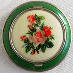 Vintage Powder Compact, Green Enamel with Pink Rose Bouquet Design. $43.00, via Etsy.