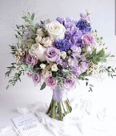 Numerous brides may know the wedding event flower they desire in their own bouquet, but are a little mystified about the remainder of the wedding flowers needed to complete the event and reception. Purple Flower Bouquet, Purple Wedding Bouquets, Prom Flowers, Wedding Flower Arrangements, Bridal Flowers, Flower Bouquet Wedding, Floral Bouquets, Floral Arrangements, Lavender Bouquet