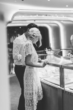 How fun would a surprise photographer and proposal in a diamond store be?