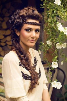 Pretty braided hairstyle that would be perfect for a prom or wedding