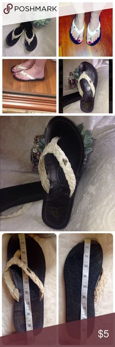 """Roxy flip flops These are an off white and dark leather brown Roxy flip flops. Again no size sticker most likely a size 7. Measurements on pictures, about 10"""" inches. They do show signs of wear, and the wooden logo pin on the left its chipped, it will be priced accordingly‼️ Roxy Shoes Sandals"""