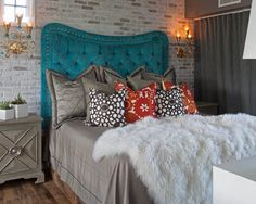 The headboard is dramatic at a great height, a great bedding to complement and you have a fresh bedroom.