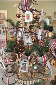 Bed Springs Christmas Tree + lots of ideas for using repurposed items in holiday decor.