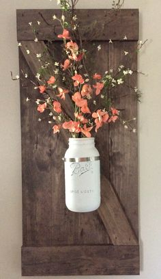 DIY Barn shutters with large spray painted and distressed mason jar and Hobby Lobby flowers.