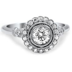 Inspired by an antique ring, this design features a dazzling bezel set center diamond encircled by a scallop-edged diamond halo. Milgrain detail surrounding the diamonds enhances the vintage feel.